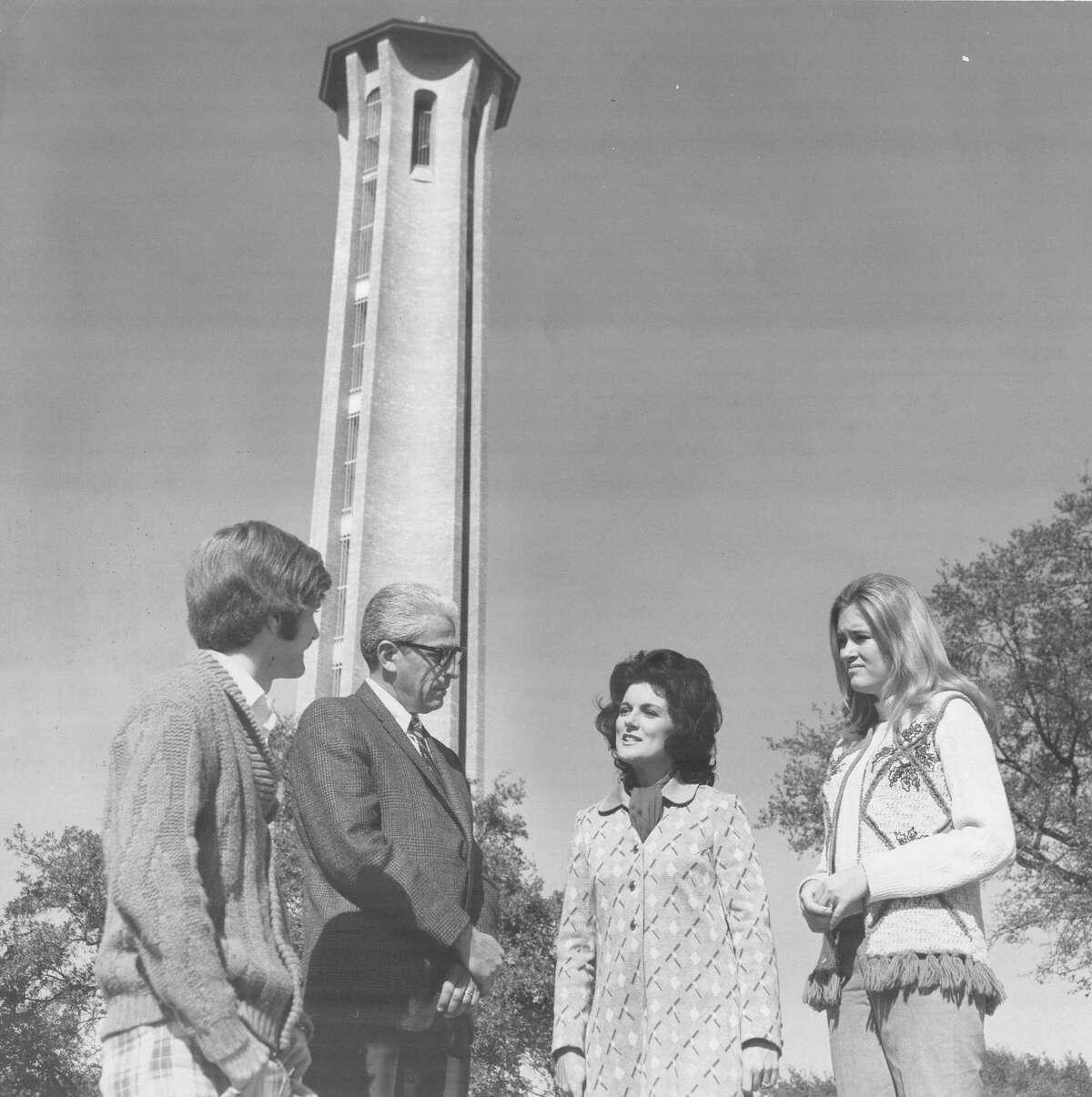 WOAI-TV's Martha Buchanan talks with Trinity University's Dean of Studen Affairs J.C. Pool and students Lou Ann Weber and Rex Smith on campus during the making of a documentary shown on the station in 1971.