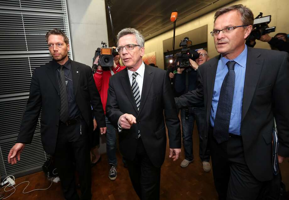 German Interior Minister Thomas de Maiziere (center) leaves Parliament after testifying behind closed doors in Berlin. Photo: Adam Berry, Getty Images