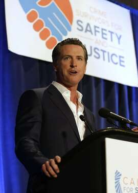 In this photo taken Monday, April 20, 2015, Lt. Gavin Newsom  speaks at the  Californians for Safety and Justice conference in Sacramento, Calif.  Newsom and former state Sen. Sam Blakeslee, R-San Luis Obispo, have teamed up with computer scientists at Cal Poly San Luis Obispo on a web-based video search engine that they hope will democratize government by using the latest in voice- and face-recognition software to allow people to see, hear and read what their representatives are doing in the state capital.  (AP Photo/Rich Pedroncelli)
