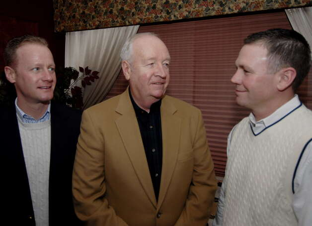 Thomas Constantine, center, former State Police superintendent and head of the federal Drug Enforcement Administration, is flanked by his sons Kevin, left, and Thomas, at an event in Schenectady in December 2006. (Skip Dickstein/Times Union archive) Photo: SKIP DICKSTEIN / ALBANY TIMES UNION
