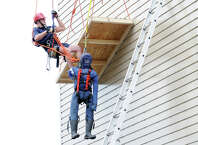 Greenwich firefighterJohn Polmon participates in the high angle rope rescue training simulating rescuing a window washer on the side of a building at the firefighter training facility off of North Street in Greenwich, Conn., Wednesday, May 6, 2015.