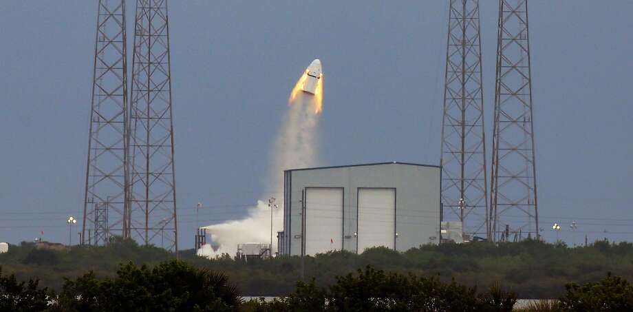 SpaceX's Dragon capsule launches, Wednesday, May 6, 2015, from Cape Canaveral, Fla. SpaceX fired the mock-up capsule to test the new, super-streamlined launch escape system for astronauts. (Red Huber/Orlando Sentinel via AP) Photo: Red Huber, Associated Press
