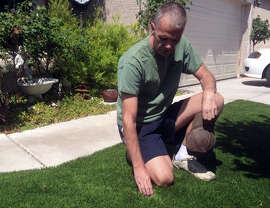 Ron Newsome of North Las Vegas found another benefit of fake grass: Dogs do their stuff elsewhere.