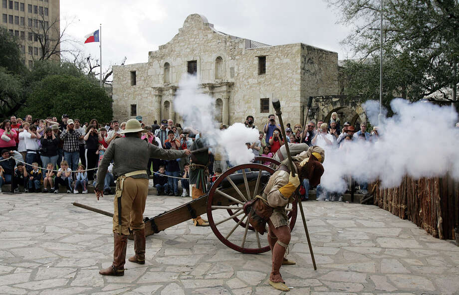 """Members of the San Antonio Living History Association demonstrate the firing of a """"four-pound"""" cannon in front of the Alamo as part of """"Remembering The Alamo"""" weekend on Saturday, Mar. 5, 2005. The non-profit organization presented re-enactments of the battle at the Alamo to audiences to provide a understanding of the people who fought and died at the mission in March of 1836. (Kin Man Huistaff) Photo: KIN MAN HUI, STAFF / SAN ANTONIO EXPRESS-NEWS / SAN ANTONIO EXPRESS-NEWS"""