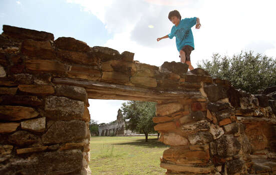 Zachary Ahr, 8 plays on some ruins near where his ancestors lived during the Bergs Mill reunion at Mission San Juan Capistrano in San Antonio, Texas on Saturday, September 4, 2010. (ALICIA WAGNER CALZADA/ SPECIAL TO THE EXPRESS-NEWS) Photo: ALICIA WAGNER CALZADA, FREELANCER / SPECIAL TO THE EXPRESS-NEWS / Alicia Wagner Calzada
