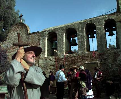 John Mione as Father Serra looks skyward for swallows following the ringing of the bells on Saturday morning, March 17, 2001 at the Mission San Juan Capistrano during the return of the swallows celebration which has been going on since 1936. No swallow were sighted yet. (AP Photo/Bob Grieser) Photo: BOB GRIESER, STR / AP / AP