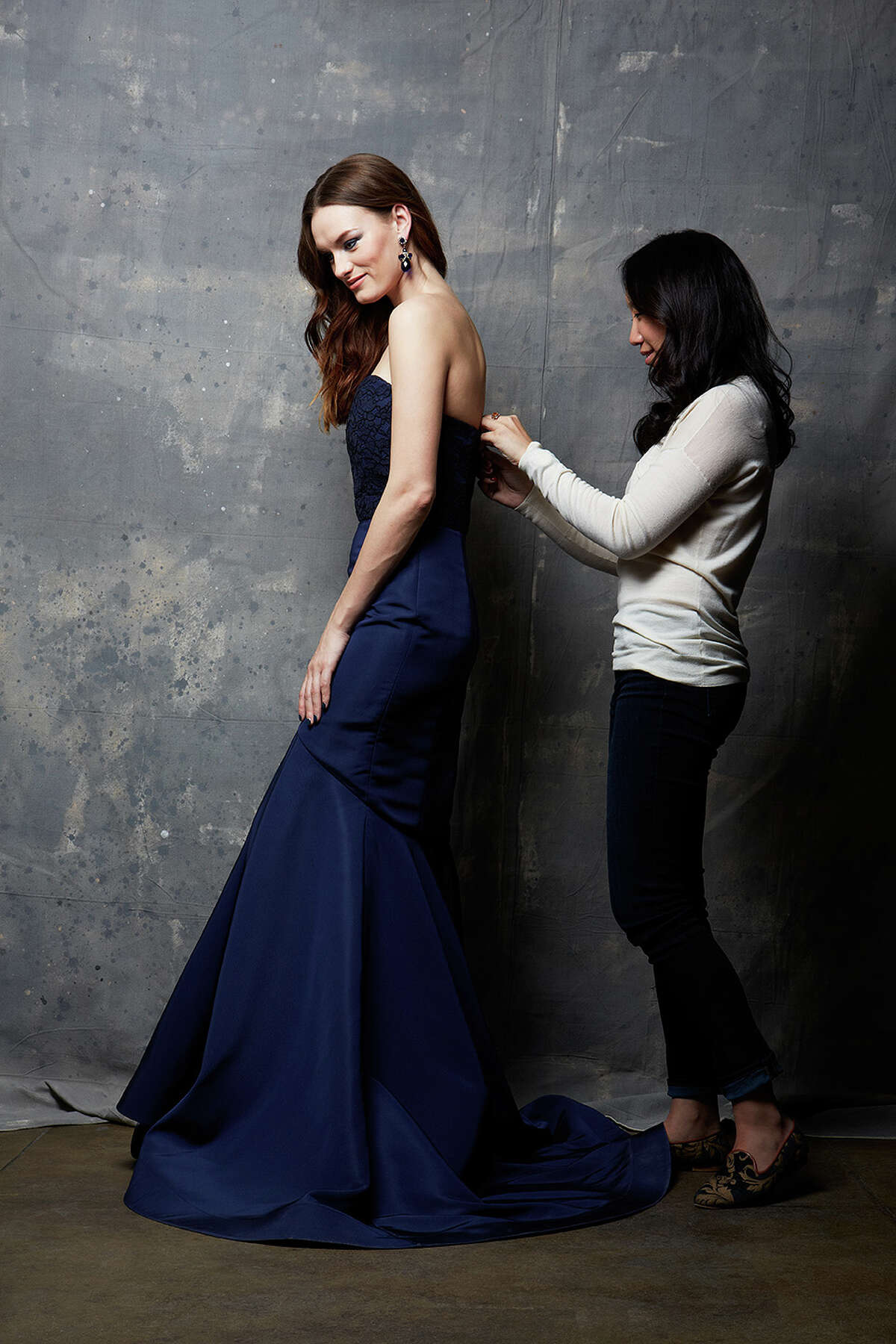 Greenwich designer Katie Fong works on one of her custom dresses.