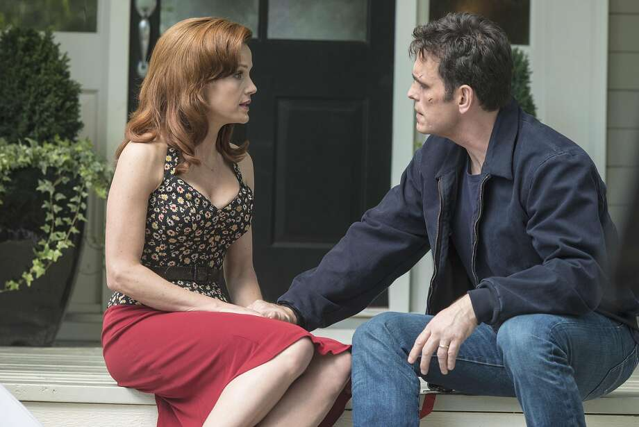 Kate (Carla Gugino) and Ethan (Matt Dillon) attempt to talk despite the constant surveillance in the town of Wayward Pines in Fox's creepy new summer offering. May, 2015 Photo: Fox