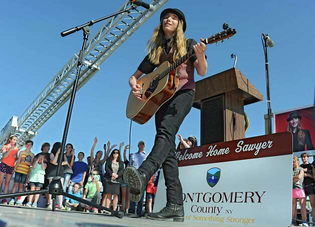 Fultonville's own Sawyer Fredericks performs at the Fonda Speedway in front of excited fans on Wednesday, May 6, 2015 in Fonda, N.Y. The 16-year-old singer/songwriter is one of the final six contestants on NBC's show The Voice. (Lori Van Buren / Times Union) Photo: Lori Van Buren / 00031668A