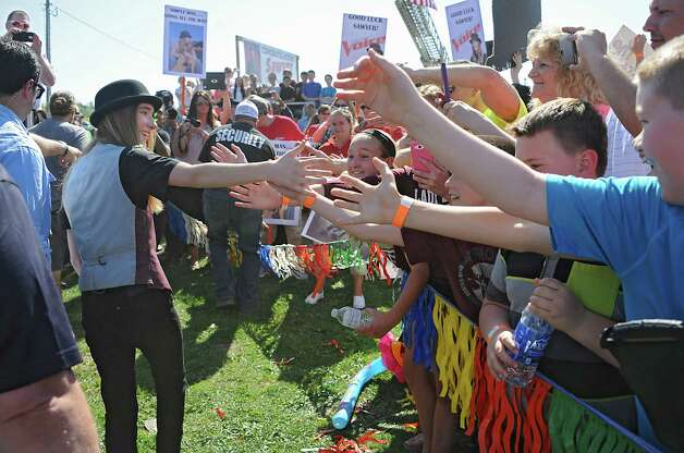 Fultonville's own Sawyer Fredericks arrives to the Fonda speedway to perform in front of excited fans on Wednesday, May 6, 2015 in Fonda, N.Y. The 16-year-old singer/songwriter is one of the final six contestants on NBC's show The Voice. (Lori Van Buren / Times Union) Photo: Lori Van Buren / 00031668A