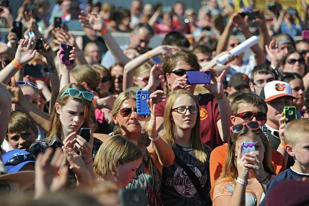 Fans listen and take photos as Fultonville's own Sawyer Fredericks performs at the Fonda Speedway on Wednesday, May 6, 2015 in Fonda, N.Y. The 16-year-old singer/songwriter is one of the final six contestants on NBC's show The Voice. (Lori Van Buren / Times Union) Photo: Lori Van Buren / 00031668A