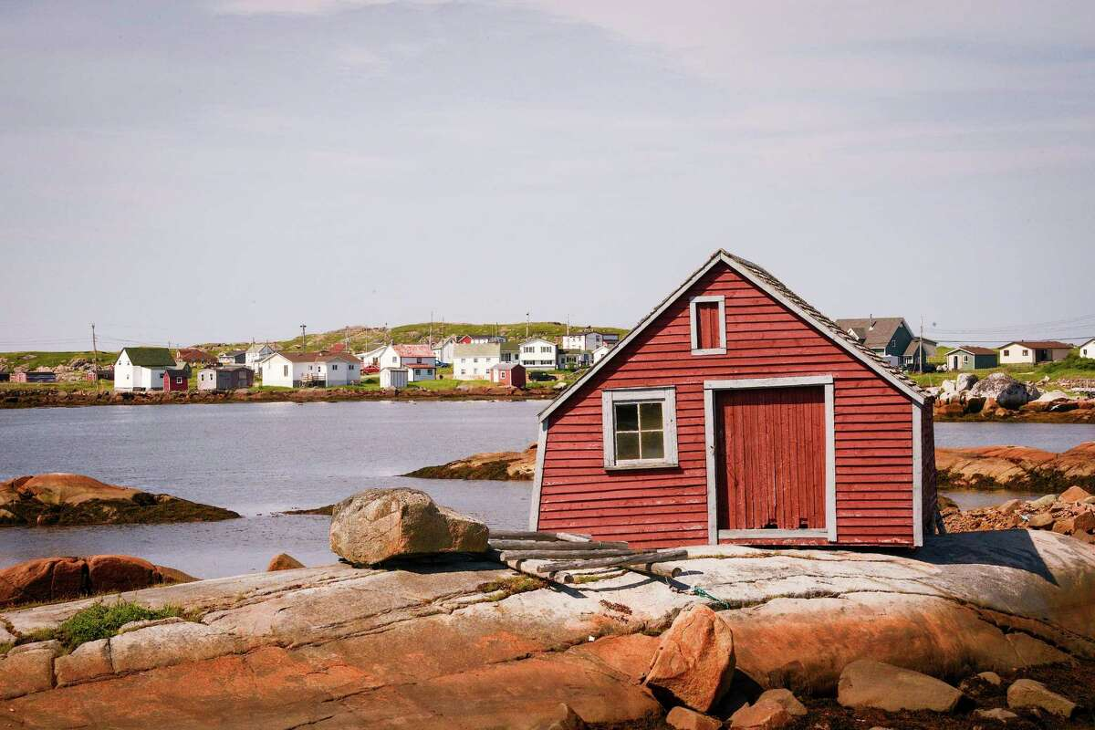 Fishing stages on Fogo Island, painted red, dot the shoreline.