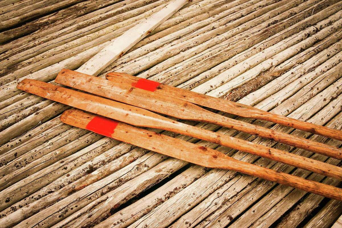 Oars used for rowing punts await use.