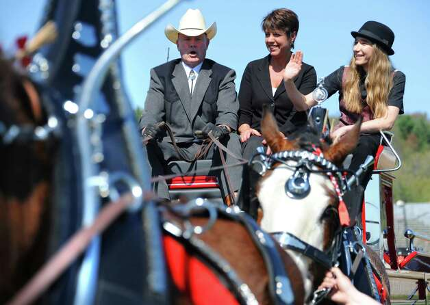Horses pull John Leavitt, left, Stephanie Palmatier and Sawyer Fredericks, right, at the end of a parade to the Fonda Speedway on Wednesday, May 6, 2015 in Fonda, N.Y. The 16-year-old singer/songwriter is one of the final six contestants on NBCOs show The Voice. John and Stephanie own the Heather Brooke Hill Clydesdales. (Lori Van Buren / Times Union) Photo: Lori Van Buren / 00031668A