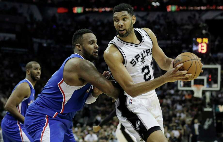 Spurs forward Tim Duncan looks to post up Los Angeles Clippers forward Glen Davis during the second half of Game 4on April 26, 2015, in San Antonio. Photo: Darren Abate /Associated Press / FR115 AP