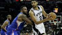 Spurs forward Tim Duncan looks to post up Los Angeles Clippers forward Glen Davis during the second half of Game 4on April 26, 2015, in San Antonio.