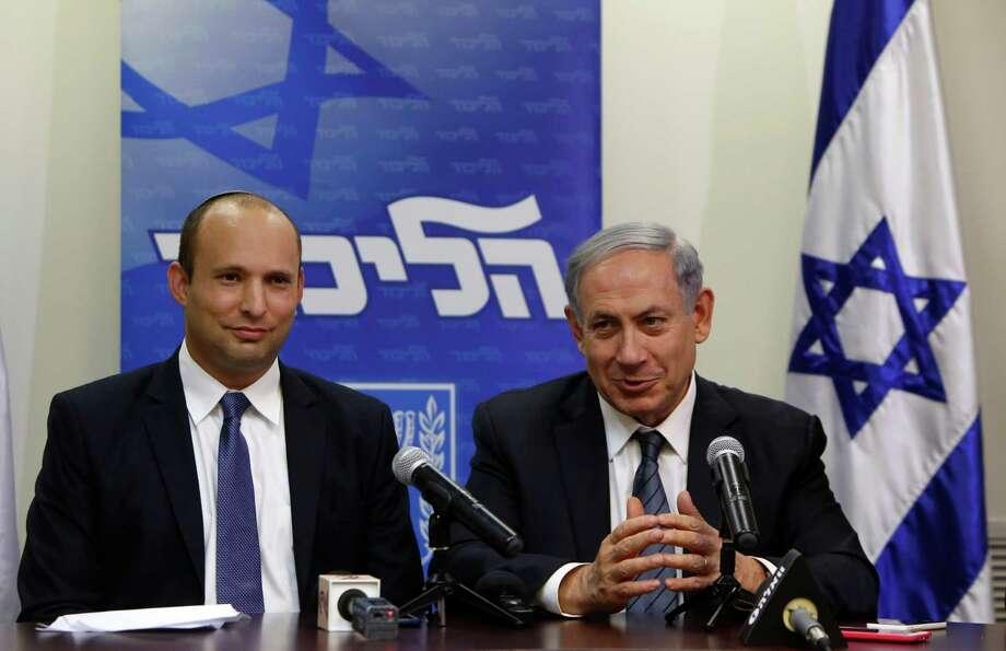 Prime Minister Benjamin Netanyahu (right) and Naftali Bennett smile after striking a deal. Photo: GALI TIBBON / AFP / Getty Images / AFP