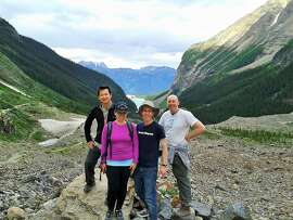 George Hwee, Jen Bennett, Jason Bennett and James Russell hiking near Lake Louise in Banff National Park.
