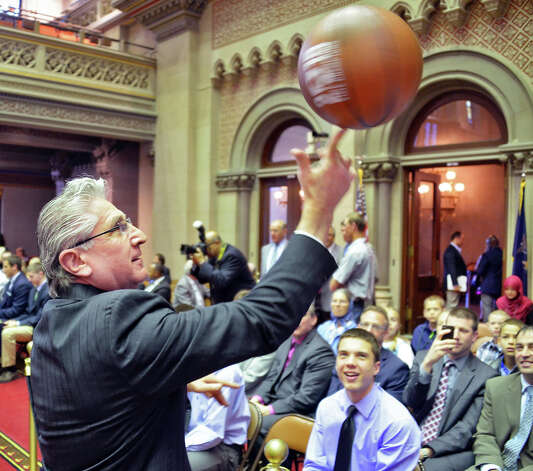 Assemblyman James Tedisco shows off some of his basketball skills to the Scotia boys' basketball team during their trip to the NYS Assembly to be honored for their state championship Wednesday May 6, 2015 at the Capitol in Albany, NY. (John Carl D'Annibale / Times Union) Photo: John Carl D'Annibale, Albany Times Union / 00031731A