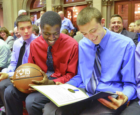 Scotia basketball players Rhys TenEyck, left, Diamond Corker and Joe Cremo, right, during their trip to the NYS Assembly to be honored for their team's state championship Wednesday May 6, 2015 at the Capitol in Albany, NY. (John Carl D'Annibale / Times Union) Photo: John Carl D'Annibale, Albany Times Union / 00031731A