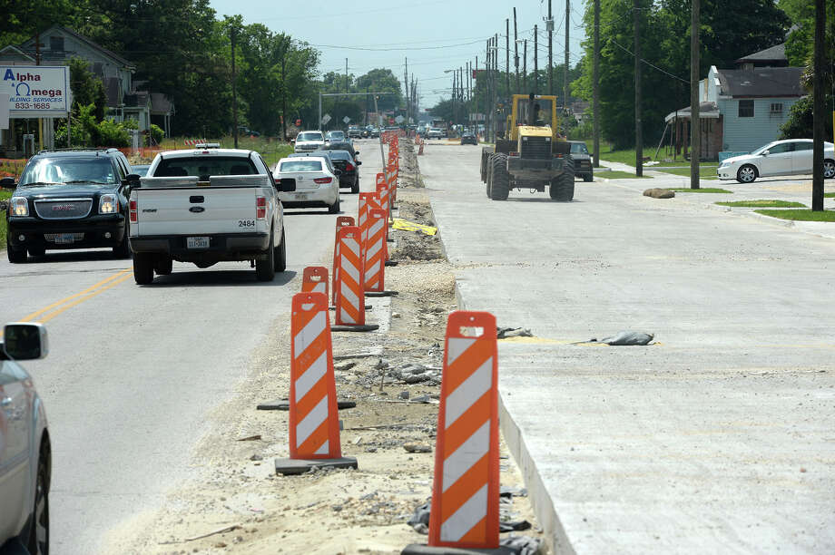 Traffic flows along Washington Boulevard in Beaumont in May 2015. Earlier this year, construction took place to open sidewalks and a new left-turn lane.  Photo: Guiseppe Barranco, Photo Editor