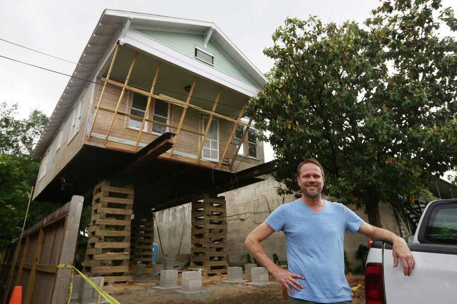 Heights remodeler jacks up house to add on below houston for How to add a second story to a house