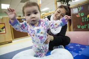 Healy-Murphy Center junior Gabriella Munoz, 17, plays with her daughter Ambriella Ramon, of five months, after finishing classes Wednesday Dec. 3, 2014 at the Healy Murphy Child Care Center. Photo by Julysa Sosa for the San Antonio Express-News
