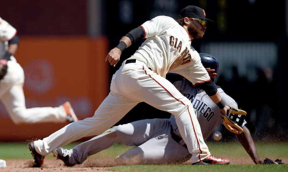The Padres' Justin Upton steals second base in the eighth inning, beating the throw to the Giants' Brandon Crawford. Upton drew a career-high four walks. Photo: Thearon W. Henderson / Getty Images / 2015 Getty Images