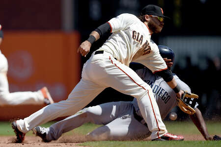 The Padres' Justin Upton steals second base in the eighth inning, beating the throw to the Giants' Brandon Crawford. Upton drew a career-high four walks.