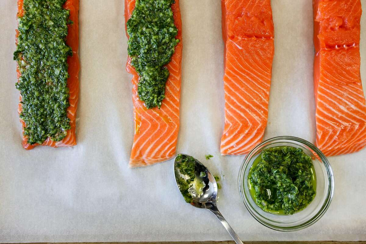 Slow-broiled salmon with an green herb, shallots, and oil rub in San Francisco, Calif., on Wednesday, May 6, 2015.