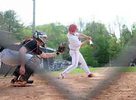 Paul Williams of Greenwich gets a hit driving in his teammate Paul Williams during the high schoo baseball game between Greenwich High School and Ridgefield High School at Greenwich, Conn., Wednesday, May 6, 2015.