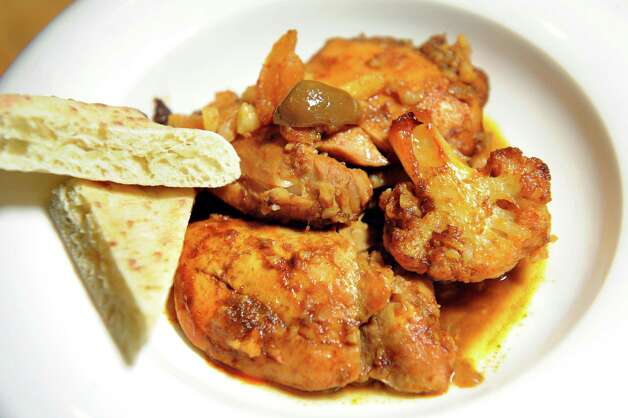 Chicken Tagine with pita bread on Thursday, April 30, 2015, at Caroline Barrett's home in Delmar, N.Y. (Cindy Schultz / Times Union) Photo: Cindy Schultz / 00031596A