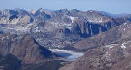 Saddlebag Lake viewed from Mount Dana in drought conditions -- with no snowpack in the high Sierra Nevada, lakes that rely solely on snowmelt are low. Saddlebag Lake, the highest drive-to lake in California at 10,087 feet, is 9 percent full and usually fills in May and June from snowmelt. Not this year.