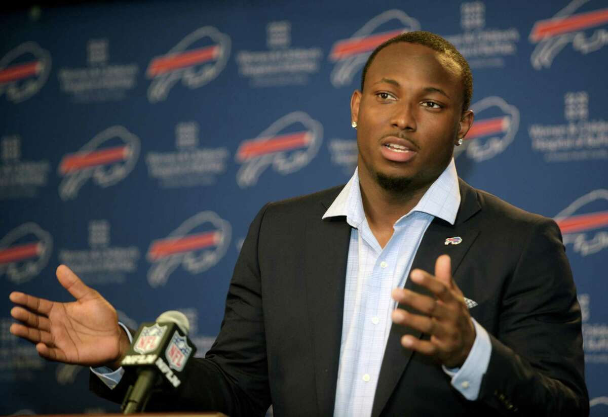 """FILE - In this March 10, 2015, file photo, Buffalo Bills running back LeSean McCoy speaks to the media during a press conference in Orchard Park, N.Y. Bills coach Rex Ryan has no intention of putting """"a muzzle"""" on his players. And that includes running back LeSean McCoy for questioning the motivations of his former coach, Chip Kelly. Ryan responded Wednesday, May 6, 2015, after McCoy created a stir for telling ESPN The Magazine that """"there's a reason (Kelly) got rid of all the black players"""" in Philadelphia. (AP Photo/Gary Wiepert, File)"""