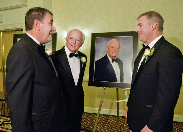 Tech Valley Hall of Fame's newest inductees George M. Philip, left,retired from University at Albany, Hugh Johnson of Hugh Johnson Advisors and James A. Clark III, right, receiving the award for his late father James A. Clark Jr. (in portrait) at a ceremony Wednesday May 6, 2015 in Colonie, NY.  (John Carl D'Annibale / Times Union) Photo: John Carl D'Annibale / 00031719A