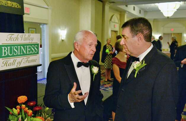 Hugh Johnson, left, of Hugh Johnson Advisors and George M. Philip, retired from University at Albany, at their induction into the Tech Valley Hall of Fame Wednesday May 6, 2015 in Colonie, NY.  (John Carl D'Annibale / Times Union) Photo: John Carl D'Annibale / 00031719A