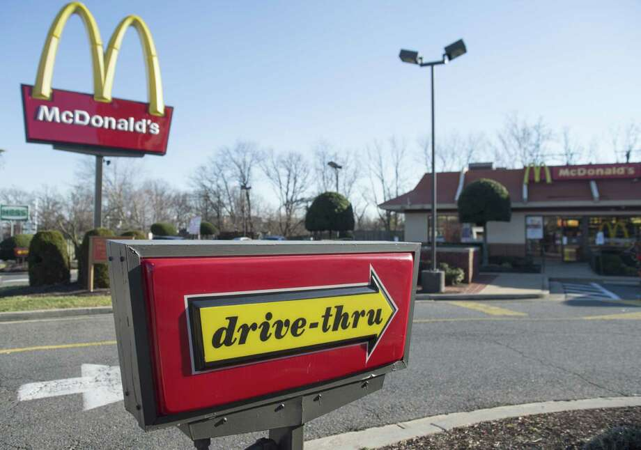 McDonald's said it would vastly reorganize its international operations and sell off more corporate sites to franchisees as it strives to reverse a trend of sagging sales. Photo: Saul Loeb /AFP / Getty Images / AFP