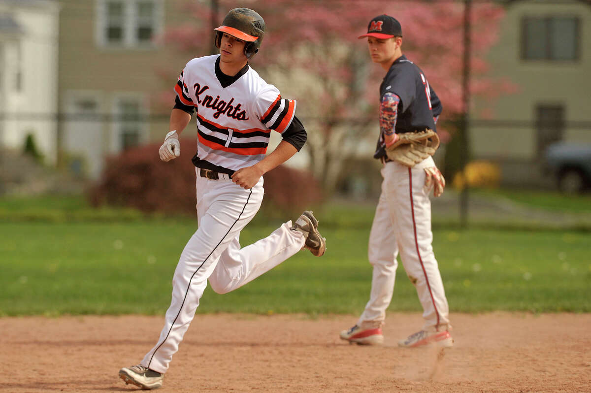 Stamford's James Gronberg rounds second base after hitting a two-run homerun in the third inning during the Black Knights' baseball game against Brien McMahon at Stamford High School in Stamford, Conn., on Wednesday, May 6, 2015. Stamford won, 9-4.