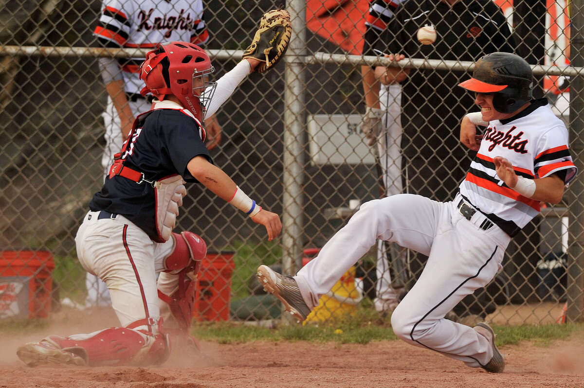 Stamford's Mark Serricchio slides safely into home beating the throw to Brien McMahon catcher Hunter Dumas during their baseball game at Stamford High School in Stamford, Conn., on Wednesday, May 6, 2015. Stamford won, 9-4.