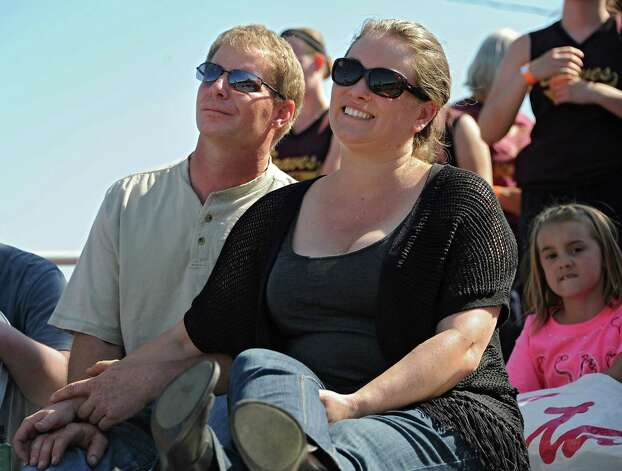 Sawyer Fredericks' proud parents Carl and Kirsten listen as their son performs at the Fonda Speedway on Wednesday, May 6, 2015 in Fonda, N.Y. The 16-year-old singer/songwriter is one of the final six contestants on NBCOs show The Voice. (Lori Van Buren / Times Union) Photo: Lori Van Buren / 00031668A