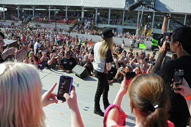 FultonvilleOs own Sawyer Fredericks walks toward some fans after performing at the Fonda Speedway on Wednesday, May 6, 2015 in Fonda, N.Y. The 16-year-old singer/songwriter is one of the final six contestants on NBCOs show The Voice. (Lori Van Buren / Times Union) Photo: Lori Van Buren / 00031668A