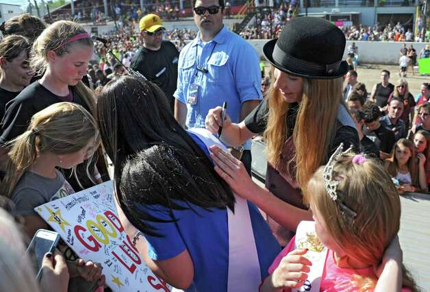 FultonvilleOs own Sawyer Fredericks meets and signs autographs for fans on stage after performing at the Fonda Speedway on Wednesday, May 6, 2015 in Fonda, N.Y. The 16-year-old singer/songwriter is one of the final six contestants on NBCOs show The Voice. (Lori Van Buren / Times Union) Photo: Lori Van Buren / 00031668A