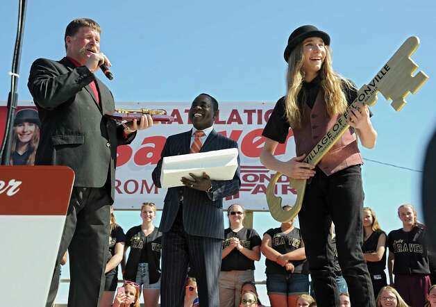 FultonvilleOs own Sawyer Fredericks, right, pretends to play air guitar with the key to the city presented by Fultonville Mayor Robert Headwell before performing at the Fonda Speedway on Wednesday, May 6, 2015 in Fonda, N.Y. The 16-year-old singer/songwriter is one of the final six contestants on NBCOs show The Voice. (Lori Van Buren / Times Union) Photo: Lori Van Buren / 00031668A