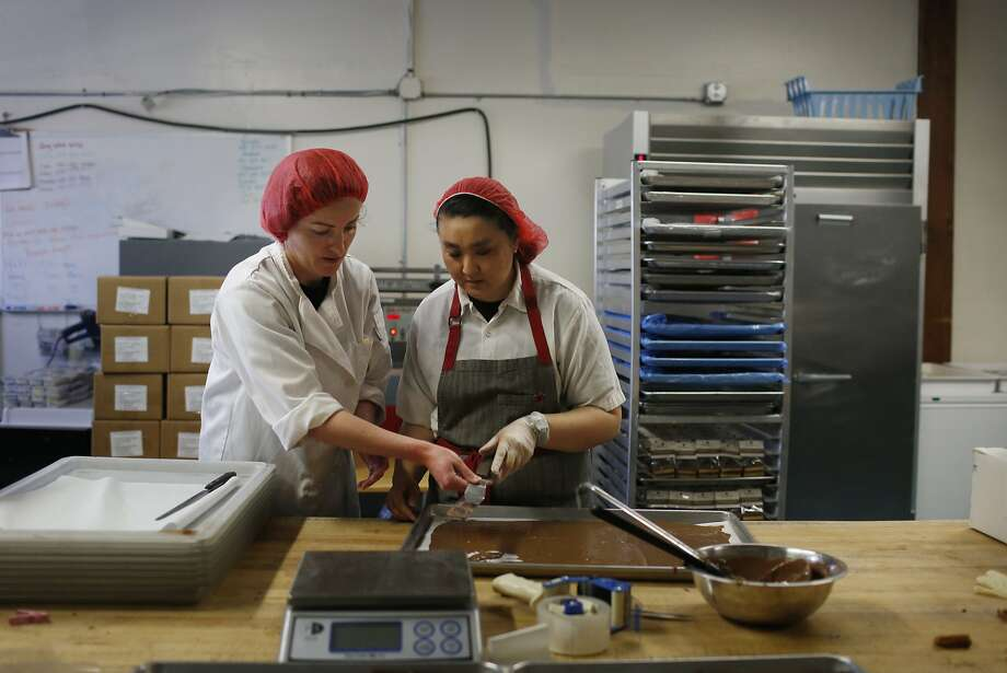 Claire Keane (l to r), owner, trains Marcella Lew for production in the production kitchen at Clairesquares on Tuesday, May 6, 2015 in Sausalito, Calif. Photo: Lea Suzuki, The Chronicle