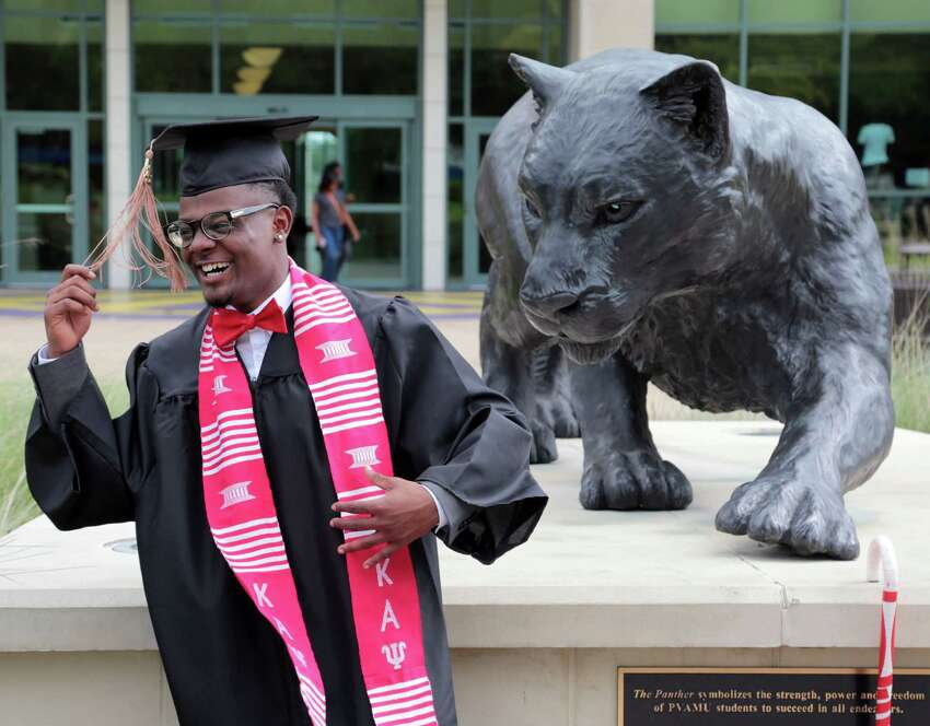 Isaiah Flanagan graduating in May with an accounting degree from Prairie View A&M University smiles for a graduation picture while on campus in Prairie View, Texas, Wednesday May 6, 2015.