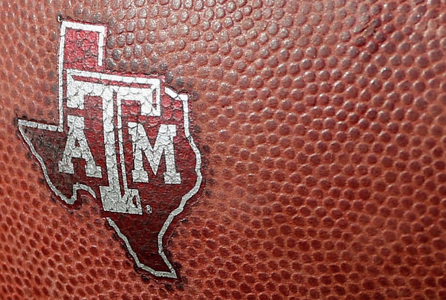 DALLAS, TX - SEPTEMBER 20:  A Texas A&M Aggies logo is seen on a football during the first half of their game against the Southern Methodist Mustangs at the Gerald J. Ford Stadium on September 20, 2014 in Dallas, Texas.  (Photo by Scott Halleran/Getty Images) Photo: Scott Halleran, Staff / Getty Images / 2014 Getty Images