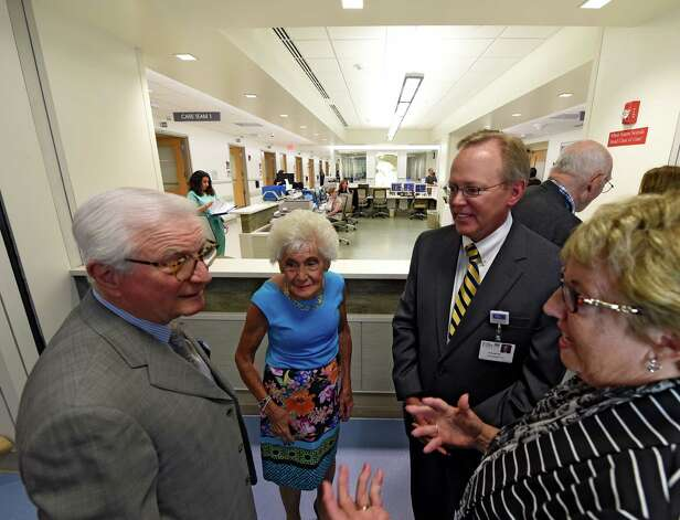 Neil Golub, left, Jane Golub, second from left, Paul Milton, president and CEO of Ellis Medicine, second from right and Board Chair Debby Mullany, right confer during the celebration of the completion of the new Neil and Jane Golub Center for Emergency Care at Ellis Hospital Wednesday morning May 6, 2015 in Schenectady, N.Y.     (Skip Dickstein/Times Union) Photo: SKIP DICKSTEIN / 00031729A