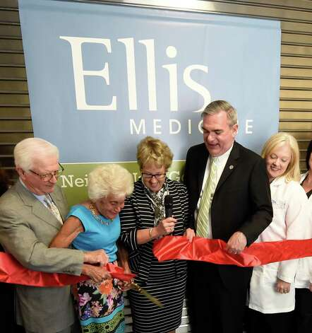 Neil and Jane Golub cut the ceremonial ribbon with the help of Ellis board chair Debby Mullany, center, Schenectady Mayor Gary McCarthy, second from right and Emergency Department director Joanne McDonough during the celebration of the completion of the new Neil and Jane Golub Center for Emergency Care at Ellis Hospital Wednesday morning May 6, 2015 in Schenectady, N.Y.     (Skip Dickstein/Times Union) Photo: SKIP DICKSTEIN / 00031729A