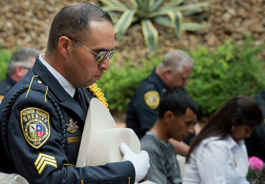 Bexar County Sheriff Dept. honor guard supervisor, Sgt. Jerry Garza, a 23-year veteran of the department, holds his hat during a prayer during the Bexar County Sheriff's Office annual memorial service for fallen deputies, Wednesday, May 6, 2015, in San Antonio. Photo: Darren Abate /For The San Antonio Express-News / San Antonio Express-News