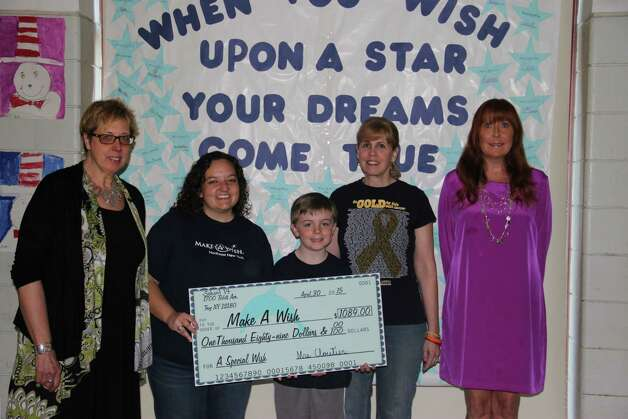 Troy School 14 students present a check to the Make-A-Wish Foundation for $1,100. Students raised the funds by collecting spare change and asking for donations. From left are School 14 Special Education Consultant Susan Tario, left, Make-A-Wish Manager of Special Events and Annual Giving Kirsten Broschinsky, Christian Rasmussen, Luanne Rasmussen, and School 14 Principal Karen Cloutier.
